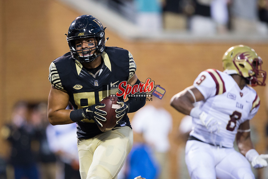 Cam Serigne (85) of the Wake Forest Demon Deacons catches a touchdown pass during first half action against the Elon Phoenix at BB&T Field on September 3, 2015 in Winston-Salem, North Carolina.   (Brian Westerholt/Sports On Film)