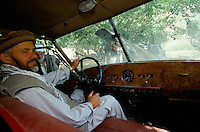 Commander Idi Abdul Tarak in autumn 2001, on the driving seat of the English black Austin A135 Princess Vanden Plas Limousine in the Panshir Valley.