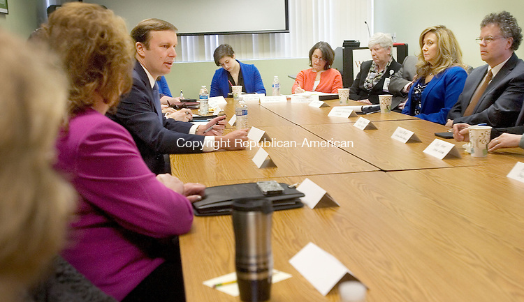 WATERBURY CT. 13 April 2015-041315SV04-Sen. Christopher S. Murphy, D-Conn, left, speaks during a roundtable discussion on the importance of addressing mental health prevention, intervention, and treatment in the 114th Congress at Wellmore in Waterbury Monday. <br /> Steven Valenti Republican-American