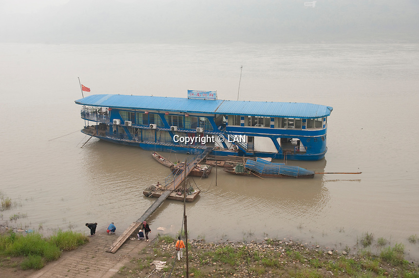 Daytime landscape view of a docked river ferry boat on the Cháng Jiāng at the Lizhuang old town port in the Yíbīn county Cuiping District in Sichuan Province.  © LAN
