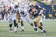 Annapolis, MD - September 9, 2016: Navy Midshipmen fullback Chris High (33) runs past Connecticut Huskies linebacker Vontae Diggs (13) during game between UConn and Navy at  Navy-Marine Corps Memorial Stadium in Annapolis, MD. September 9, 2016.  (Photo by Elliott Brown/Media Images International)