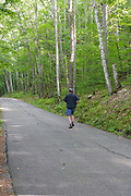 Weeks State Park - Man jogging at John Wingate Weeks Estate on the summit of Mt. Prospect in Lancaster, New Hampshire USA. The Mount Prospect Tower was built by John W. Weeks in 1912 and is still in operation today