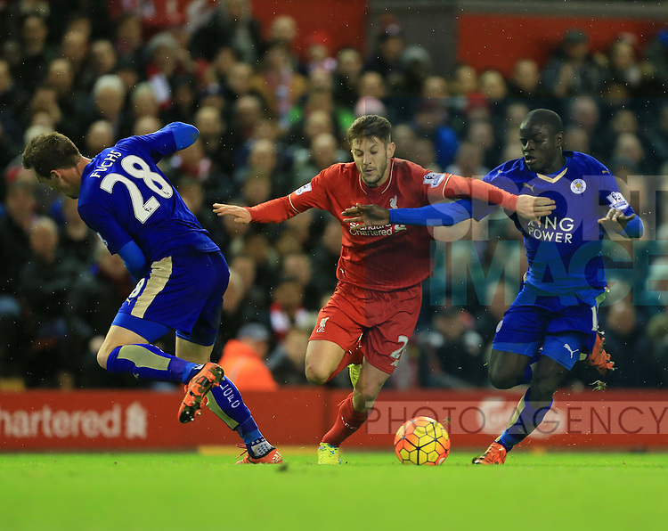 Liverpool's Adam Lallana tussles with Leicester's Christian Fuchs and N'Golo Kante<br /> <br /> Barclays Premier League- Liverpool vs Leicester City - Anfield - England - 26th December 2015 - Picture David Klein/Sportimage