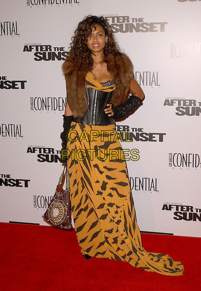 "SHAKARA LEDARD.The New Line Cinema's L.A. Premiere of ""After the Sunset"" held at The Mann's Chinese Theatre in Hollywood, California .November 4, 2004.full length, fur collar, trim, hand on hip, corset, bustier, leather, yellow and black animal print dress.www.capitalpictures.com.sales@capitalpictures.com.© Capital Pictures."