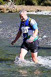 NELSON LAKES, NEW ZEALAND - APRIL 18:  Mark Lockington crosses the Travers River during the 2015 Alpine Lodge Loop The Lake trail run at Lake Rotoiti on April 18 16, 2015 in Nelson, New Zealand. (Photo by Marc Palmano/Shuttersport Limited)