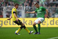 FUSSBALL   1. BUNDESLIGA   SAISON 2011/2012   26. SPIELTAG Borussia Dortmund - SV Werder Bremen               17.03.2012 Lukasz Piszczek (li, Borussia Dortmund) gegen Florian Hartherz (re, SV Werder Bremen)