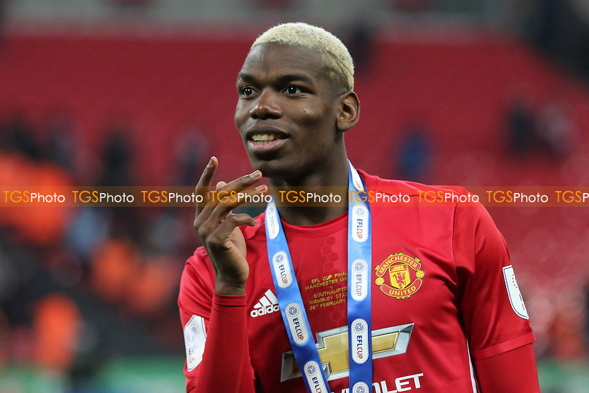 Paul Pogba interacts with the Manchester United fans as he celebrates their Cup victory during Manchester United vs Southampton, EFL Cup Final Football at Wembley Stadium on 26th February 2017