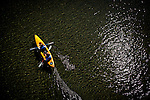Kayakers in Adventure Rents kayaks paddle the Gualala River in Gualala, Calif., on July 3, 2011.