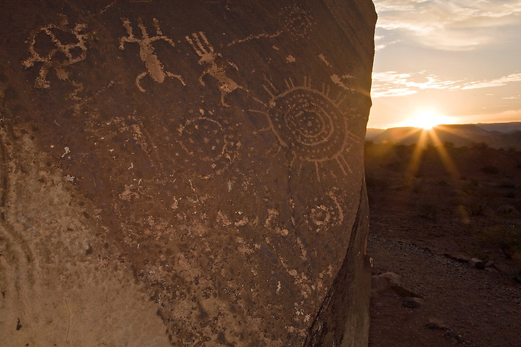 Petroglyphs at the Little Black Mountain Petroglyph Site watch the sun rise over the Hurricane Cliffs