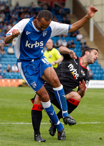 5th September 2009. Exeter City striker Stuart Fleetwood (in black) clashes with Josh Gowling during the second half. Division 1 match - Gillingham v Exeter City at Priestfield Stadium, Gillingham, Kent, England.Photo: Colin Read/Actionplus.