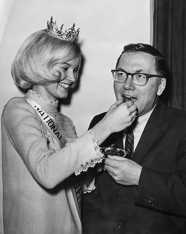 Sen. Robert P. Griffin, R-Mich. with Nail Cherry Queen Julie Hamilton in 1966. (Photo by CQ Roll Call)