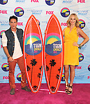 UNIVERSAL CITY, CA - JULY 22: Michael Trevino and Candice Accola pose in the press room at the 2012 Teen Choice Awards at Gibson Amphitheatre on July 22, 2012 in Universal City, California.