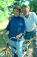 Spouses age 51 and 46 resting on bicycle jaunt.  St Paul  Minnesota USA