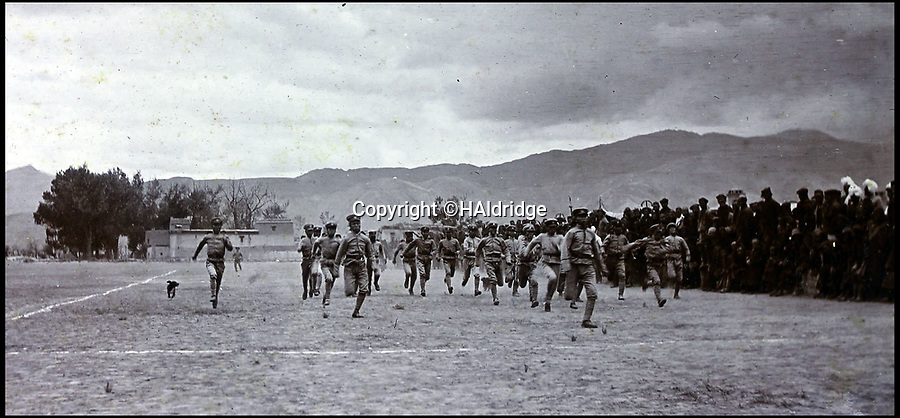 BNPS.co.uk (01202 558833)Pic: HAldridge/BNPS<br /> <br /> Gurkha troops in a sprint race.<br /> <br /> Game tales from the hills...remarkable album shows British attempts to win over newly invaded Tibet by playing sport's straight from the playing fields of England.<br /> <br /> A collection of photos have come to light which show the people of the remote Himalayan nation of Tibet embracing one of the traditional British pastimes - a sports day.<br /> <br /> The archive of more than 500 photos was collated by a British Lieutenant Colonel, R C MacGregor, of the Indian Medical Service, who was present in Tibet between 1904 and 1912.<br /> <br /> These photos are one of the earliest examples of the British attempting to win 'the hearts and minds' of a native population as they were taken during the controversial Younghusband expedition to the distant Buddhist country.<br /> <br /> The archive also features four never before seen photos of the Dalai Lama returning to Tibet in 1912 after his exile ended.