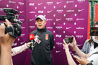 14th May 2020, Suzhou, southeastern Jiangsu Province of East China;  Jia Xiuquan R, head coach of Chinas womens national football team speaks to reporters after an open training session in Suzhou