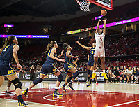COLLEGE PARK, MD - DECEMBER 28: Kaila Charles #5 of Maryland goes up over Kayla Robbins #5 of Michigan for a rebound. during a game between University of Michigan and University of Maryland at Xfinity Center on December 28, 2019 in College Park, Maryland.
