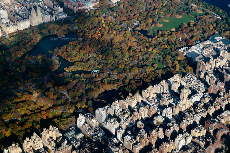 An aerial view of Manhattan buildings and Central Park in New York, New York.