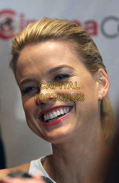 Alice Eve.Paramount Pictures hosts opening night event at CinemaCon 2013 at Caesars Palace, Las Vegas, NV., USA..April 15th, 2013.headshot portrait smiling teeth .CAP/ADM/MJT.© MJT/AdMedia/Capital Pictures