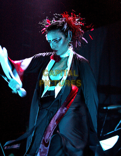 SIOUXSIE SIOUX.perform live for The VH1 Classics, a Night with Siouxsie held at The House of Blues in Anaheim, California .September 19, 2004.half length, stage, concert, music, live, singing, the banshees.www.capitalpictures.com.sales@capitalpictures.com.Copyright by Debbie VanStory