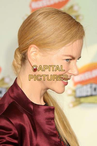 NICOLE KIDMAN .Nickelodeon's 20th Annual Kids' Choice Awards at UCLA's Pauley Pavilion, Westwood, California , USA,  .31 March 2007..portrait headshot red maroon jacket earrings profile.CAP/ADM/BP.©Byron Purvis/AdMedia/Capital Pictures.