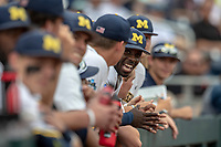 Michigan Wolverines second baseman Ako Thomas (4) laughs with his teammates before playing against the Texas Tech Red Raiders during the first game of the NCAA College World Series on June 15, 2019 at TD Ameritrade Park in Omaha, Nebraska. Michigan defeated Texas Tech 5-3. (Andrew Woolley/Four Seam Images)