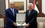 Palestinian President Mahmoud Abbas gives the Palestinian businessman Sabeeh Al-Masri the Order of the Great Star. in the West Bank city of Ramallah on October 15, 2018. Photo by Thaer Ganaim