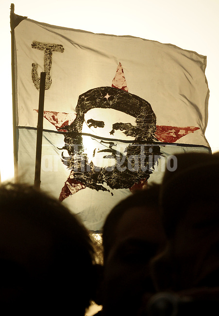 "Flags with the face of  Ernesto ""Che"" Guevara are seen at the inauguration of a statue at his birthplace of Rosario.The two-ton, four-metre bronze statue of ""Che"" Guevara was unveiled on  in the Argentine city where he was born exactly 80 years ago, the first such monument to the revolutionary in his homeland."