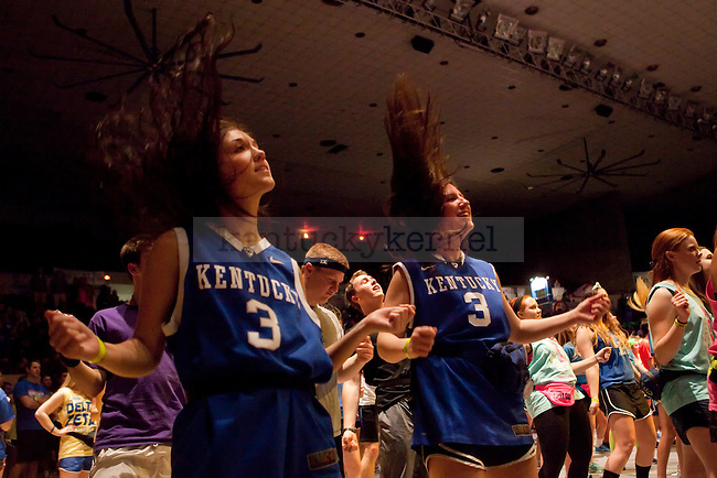Sarah Szymczak (right) and Madison Fields (left) dance during the hourly line dance at Dance Blue in Memorial Coliseum in Lexington, Ky., on Saturday, February 22, 2014. Photo by Emily Wuetcher | Staff