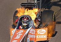 Feb. 24, 2013; Chandler, AZ, USA; NHRA top fuel dragster driver Clay Millican blows an engine on fire during the Arizona Nationals at Firebird International Raceway. Mandatory Credit: Mark J. Rebilas-