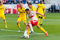 Fabian Espindola (9) of the New York Red Bulls is marked by Josh Williams (3) of the Columbus Crew. The New York Red Bulls and the Columbus Crew played to a 2-2 tie during a Major League Soccer (MLS) match at Red Bull Arena in Harrison, NJ, on May 26, 2013.