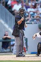 Home plate umpire Jeremy Riggs makes a strike call during the International League game between the Toledo Mud Hens and the Charlotte Knights at BB&T BallPark on June 22, 2018 in Charlotte, North Carolina. The Mud Hens defeated the Knights 4-0.  (Brian Westerholt/Four Seam Images)