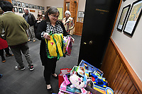 NWA Democrat-Gazette/J.T. WAMPLER Beth Priesmeyer of West Fork adds toys to a collection box Monday Dec. 2, 2019 during a Christmas Celebration for county employees and guests at the historic Washington County Courthouse in Fayetteville. People were encouraged to bring unwrapped gifts for donation to Arkansas Children's Northwest. Priesmeyer works for the Washington County collectors office.
