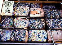 Bins of flattened recycled bottles at a processing plant in Kona.