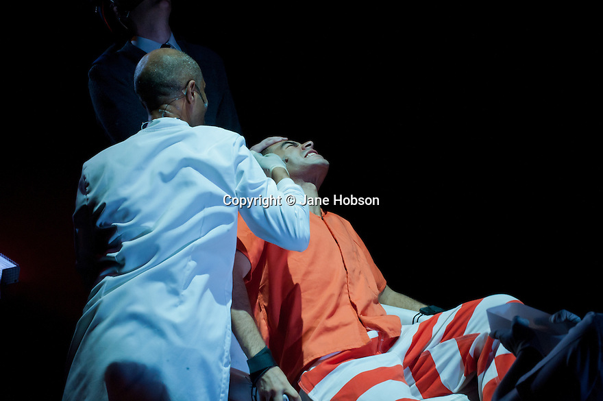 "London, UK. 09/09/2011. A new adaptation of Anthony Burgess' ""A Clockwork Orange"", with words by Ed DuRante and music by Fred Carl, Directed by Dawn Reid, premieres at Theatre Royal Stratford East. Jack Shalloo (as Hospital Guard), Richard Lloyd-King (as Doctor) and Ashley Hunter (as Alex). Photo credit: Jane Hobson"