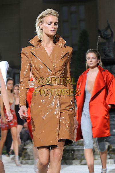 JACQUETTA WHEELER .At the Julien MacDonald Show, London Fashion Week Day 3, The Lawrence Hall. Greycoat St. London, England, UK,.September 20th 2009..half length modeling catwalk runway brown shiny pvc trench coat mac belted.CAP/CAN.©Can Nguyen/Capital Pictures.