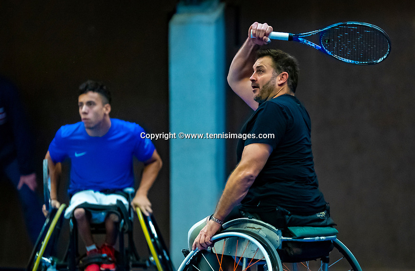 Alphen aan den Rijn, Netherlands, December 14, 2018, Tennispark Nieuwe Sloot, Ned. Loterij NK Tennis,  Wheelchair men's doubles :  Carlos Anker (NED) and Ricky Molier (NED) foreground<br /> Photo: Tennisimages/Henk Koster