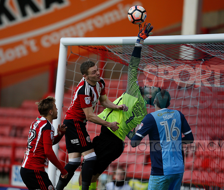 Caolan Lavery of Sheffield Utd pressures Alex Cisak of Leyton Orient during the Emirates FA Cup Round One match at Bramall Lane Stadium, Sheffield. Picture date: November 6th, 2016. Pic Simon Bellis/Sportimage