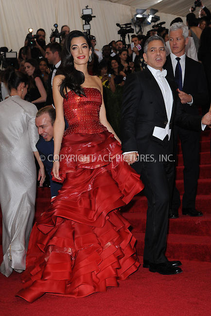WWW.ACEPIXS.COM<br /> May 4, 2015...New York City<br /> <br /> George Clooney and Amal Clooney attending the Costume Institute Benefit Gala  celebrating the opening of China: Through the Looking Glass at The Metropolitan Museum of Art on May 4, 2015 in New York City.<br /> <br /> Please byline: Kristin Callahan<br /> ACEPIXS.COM<br /> Tel# 646 769 0430<br /> e-mail: info@acepixs.com<br /> web: http://www.acepixs.com