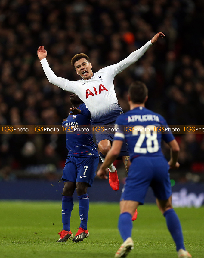 Dele Alli of Tottenham Hotspur is fouled during Tottenham Hotspur vs Chelsea, Caraboa Cup Football at Wembley Stadium on 8th January 2019