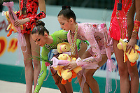 "(L-R) Mariya Mateva of Bulgaria and Daria Dmitrieva of Russia pick up their gifts during the event finals awards ceremony at 2008 World Cup Kiev, ""Deriugina Cup"" in Kiev, Ukraine on March 23, 2008."