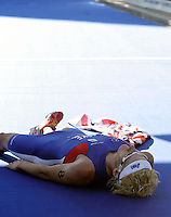 03 SEP 2006 - LAUSANNE, SUI - Will Clarke (GBR) recovers after winning the U23 Mens ITU World Triathlon Championship title (PHOTO (C) NIGEL FARROW)