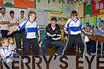 Kevin O'Mahony left and Patrick Horan dances the Huckle Buck with Crystal Swing singer Derek Burke who is Castleisland Desmonds Celebrity Banisteoir on his visit to Castleisland Boys National school on Friday.