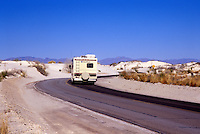 Recreational vehicle on road driving into White Sands National Park.  Alamogordo, New Mexico