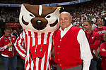 Wisconsin Badgers Athletic Director Barry Alvarez with mascot Bucky Badger during an NCAA Big Ten Conference college basketball game against the Michigan State Spartans Sunday, March 1, 2015, in Madison, Wis. The Badgers won 68-61. (Photo by David Stluka)