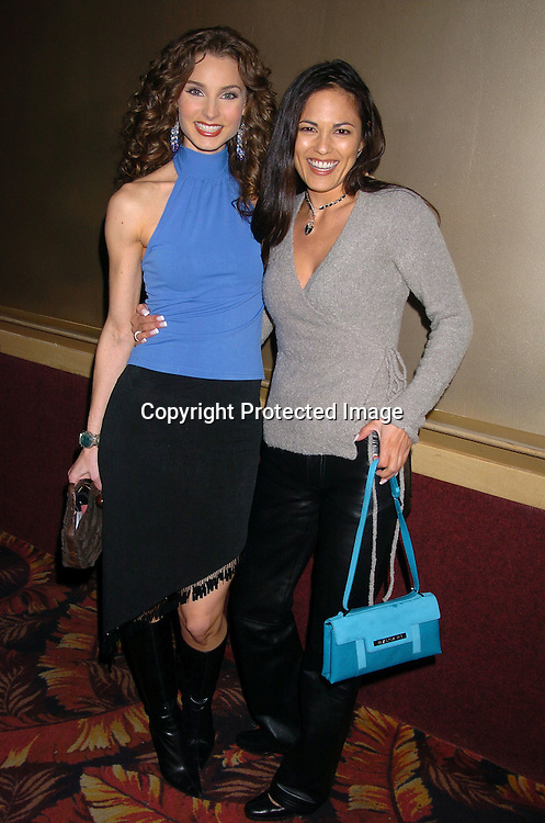 Alicia Minshew and Terri Ivens..at the All My Children Christmas party at the Copacabana  on December 17, 2003. Photo by Robin Platzer, Twin Images.