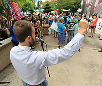 NWA Democrat-Gazette/ANDY SHUPE<br /> The Rev. Clint Schnekloth, founder and CEO of Canopy NWA and pastor of Good Shepherd Lutheran Church in Fayetteville, speaks Saturday, June 17, 2017, during the Don't Deport Dad! rally in front of the Fayetteville Towncenter. Ozark Indivisible and the Arkansas Justice Collective partnered to organize the rally to pressure the Washington County Sheriff's Office to end its efforts to assist Federal agencies in the deportation of residents.