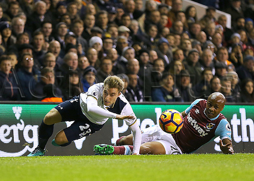 19.11.2016. White Hart Lane, London, England. Premier League Football. Tottenham Hotspur versus West Ham United. Tottenham Hotspur Midfielder Christian Eriksen gets back to his feet after beating West Ham United Forward André Ayew to the ball but slipping