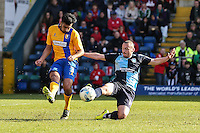 Malvind Benning of Mansfield Town and Michael Harriman of Wycombe Wanderers battle for the ball during the Sky Bet League 2 match between Wycombe Wanderers and Mansfield Town at Adams Park, High Wycombe, England on 25 March 2016. Photo by David Horn.
