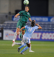 # 12 Elise Weber of St. Louis Athletica  goes up for the ball against the defense of #11 Cristiane  of the Chicago Reds. Athletica beat the Red Stars 2-0...