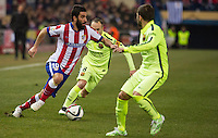 Atletico de Madrid´s Arda Turan and Barcelona´s Andres Iniesta during 2014-15 Spanish King Cup match between Atletico de Madrid and Barcelona at Vicente Calderon stadium in Madrid, Spain. January 28, 2015. (ALTERPHOTOS/Luis Fernandez) /nortephoto.com<br />